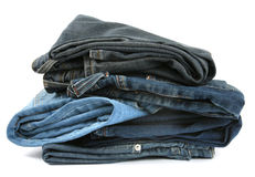 Pile of jeans. Pile of blue jeans isolated on white background Stock Images