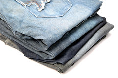 Pile of jeans. Isolated on white background Stock Photos