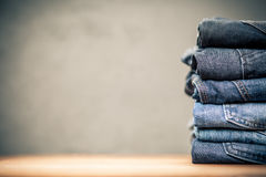 Pile of jeans. Jeans arranged in a stack Stock Photography