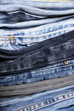 Pile of jeans. Cloe up on a pile of jeans with their different colors and textures Stock Photography