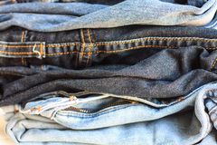 Pile of jeans. Fashionable clothes, pile of jeans Royalty Free Stock Image