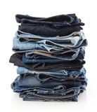 Pile of jeans. Isolated on white Stock Images