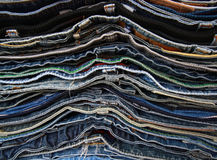 Pile of jeans of various shades Royalty Free Stock Image