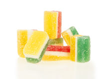 Pile of jelly sweets. Multi-colored fruit jelly sweets in sugar isolated on white background Royalty Free Stock Image