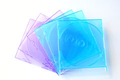 Pile of jewel cases for CD or DVD. Isolated over white royalty free stock photography