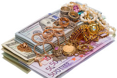 Pile of jewelry and currency Royalty Free Stock Image