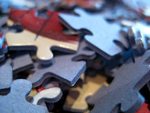 Pile of jigsaw pieces. Macro view of pile of jigsaw pieces Royalty Free Stock Images