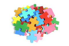 Pile of Jigsaw Puzzle Pieces. On White Background Royalty Free Stock Image