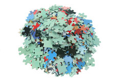 Pile of Jigsaw Puzzle Pieces. On White Background Royalty Free Stock Photos