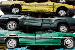 A pile of junk cars. With different colors displayed in a business street stock photos