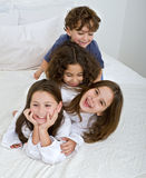 Pile of kids. Four kids piled on each other Royalty Free Stock Photography