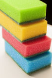 Pile of Kitchen Colorful Sponges On White Surface Against Black Royalty Free Stock Images