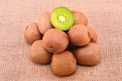 Pile of kiwi on sackcloth background Royalty Free Stock Photography