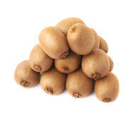 Pile of kiwifruits isolated. Pile of multiple kiwifruits or chinese gooseberry kiwi isolated over the white background Stock Photos
