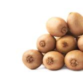 Pile of kiwifruits isolated. Pile of multiple kiwifruits or chinese gooseberry kiwi isolated over the white background Royalty Free Stock Image
