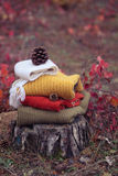 Pile knitted sweaters in the autumn Stock Images