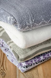 Pile knitted sweaters Stock Image