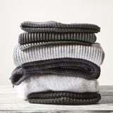 Pile of knitted winter clothes Royalty Free Stock Photos