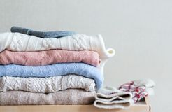 Pile of sweaters an knitwear royalty free stock photo