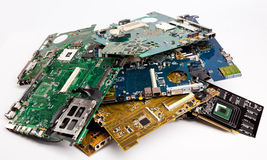 Pile of laptops mother boards Stock Photos