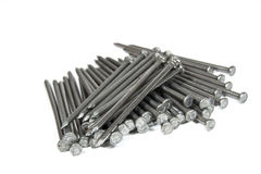 Pile of Large Steel Nails on White Royalty Free Stock Photos