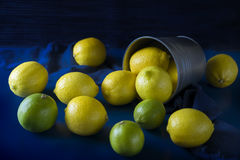 Pile of lemons on the blue background Royalty Free Stock Photography