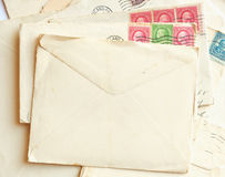 Pile of letters, post stamps and blank envelope Stock Photography