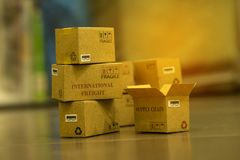 Pile of light brown small cardboard boxes. Concept of Shipping t. Hat can be done easily or purchase goods or services remotely. just using an online internet stock images