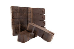 Pile of lignite with two carbon bricks in front Stock Photo