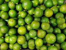 Pile of limes. Full frame of limes at market royalty free stock image
