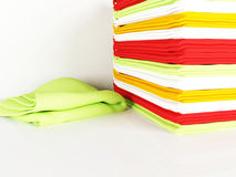 Pile of linen kitchen towels on a table Royalty Free Stock Image