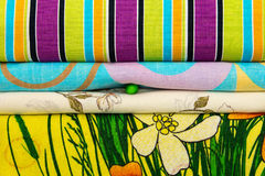 Pile of linen with pea between them. Royalty Free Stock Photos