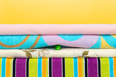 Pile of linen with pea between them. Stock Image
