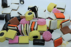 Pile of liquorice allsorts. In different shapes, colors and sizes Royalty Free Stock Photo
