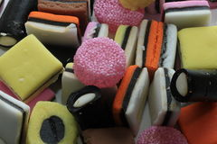 Pile of liquorice allsorts. In different shapes, colors and sizes Royalty Free Stock Image
