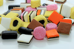 Pile of liquorice allsorts. In different shapes, colors and sizes Stock Photos