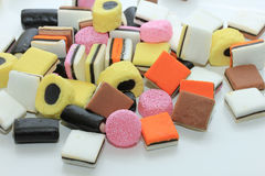 Pile of liquorice allsorts. In different shapes, colors and sizes Royalty Free Stock Images