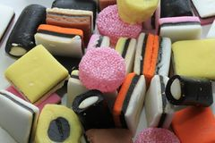 Pile of liquorice allsorts. In different shapes, colors and sizes Stock Photography