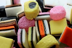 Pile of liquorice allsorts. In different shapes, colors and sizes Stock Images