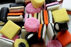 Pile of liquorice allsorts. In different shapes, colors and sizes Royalty Free Stock Photos