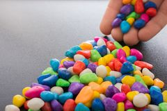 Pile of colorful pebbles as a stone background Stock Image