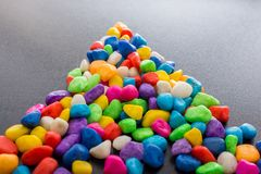 Pile of colorful pebbles as a stone background Royalty Free Stock Image