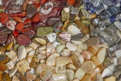 Colorful semi-precious stones on the marble background, texture. stock images