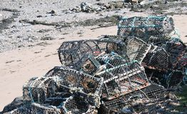 Pile of lobster of creel pots on beach. Pile of lobster of creel fishing pots on beach Royalty Free Stock Photo