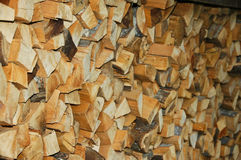 Pile of log. A pile of triangular cut log wood stock images
