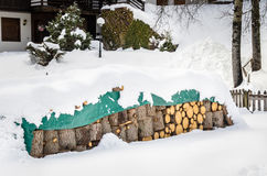 Pile Logs Covered in Snow Stock Image