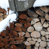 Pile of logs in winter Royalty Free Stock Photos