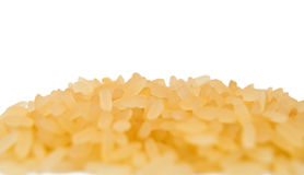Pile of long grain brown rice close-up. On white background Stock Photo
