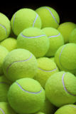 Pile of loose tennis balls stock image
