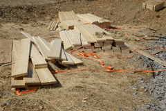 Pile of loose wood planks or lumber by a construction site Royalty Free Stock Photo